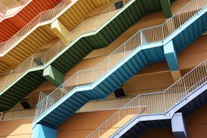 A series of coloured staircases representing the challenge of accessible colour design