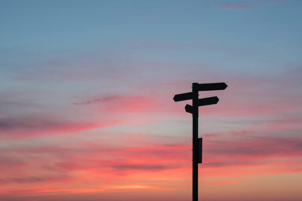 sunset with signs pointing in different directions symbolising opportunities for skills development