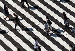 people walking over crosswalk