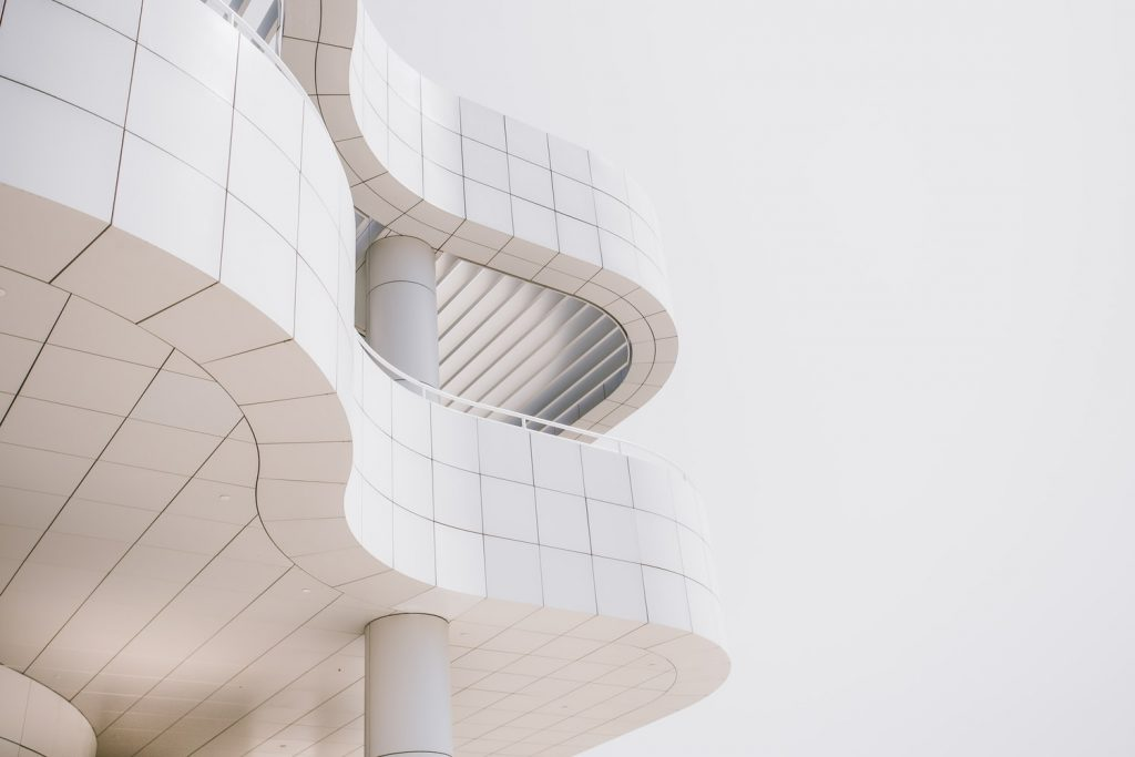 a white curvy shape building