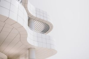 a white curvy shape building