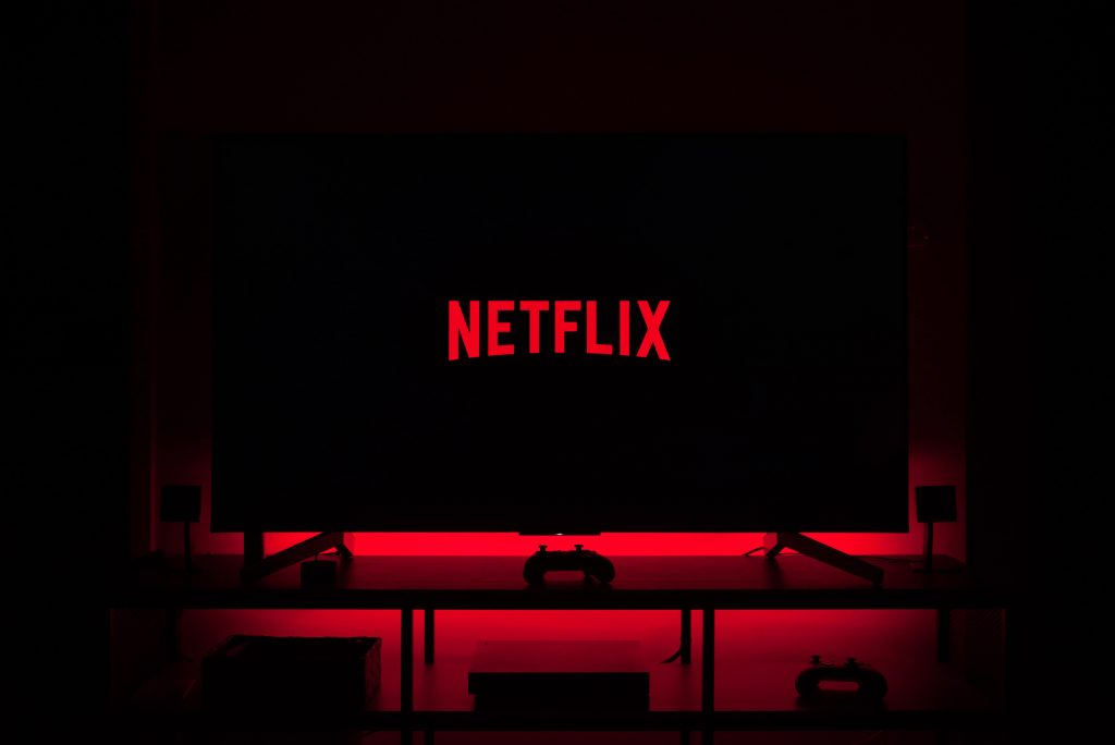 Netflix logo on a television screen surrounded by red light