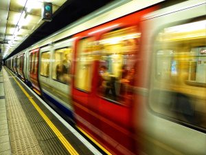 tube train moving quickly through a station
